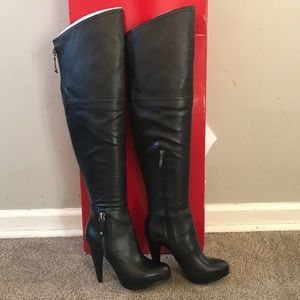 Above the knee black Guess leather boots.